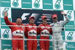 Ross Brawn, Rubens Barrichello, Michael Schumacher and David Coulthard on the podium