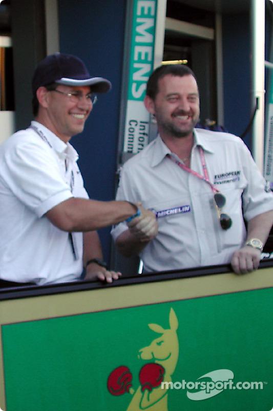 Craig McLatchey presents Paul Stoddart with the Boxing Kangaroo battle flag