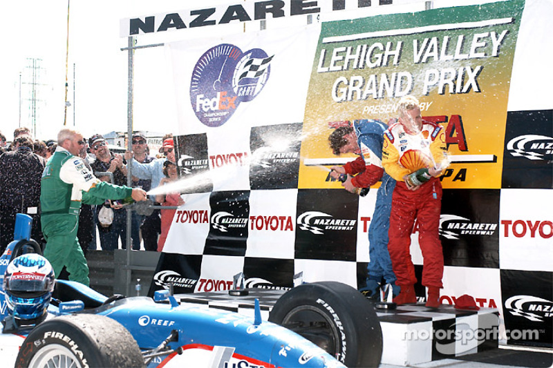 Champagne for Paul Tracy, Scott Dixon and Kenny Brack