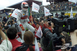 Audi driver Emanuele Pirro after crossing the finishing line with his Infineon Audi R8
