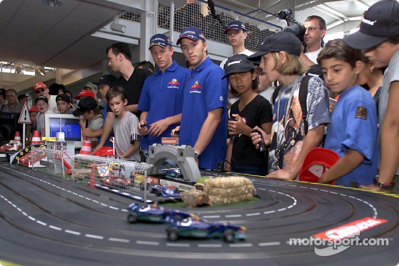 Inauguration of the new CARRERA race track at the Motorsport Museum Hockenheim: Kimi Raikkonen and N