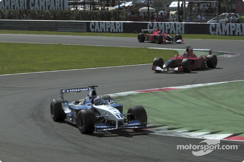 Juan Pablo Montoya in front of Rubens Barrichello and Michael Schumacher