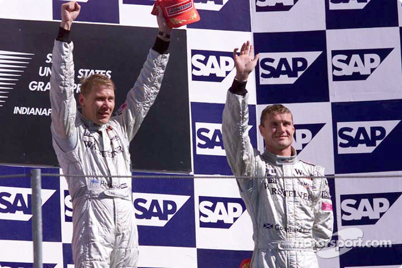 The podium: Mika Hakkinen and David Coulthard