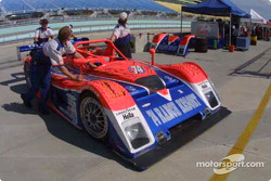 The Robinson Racing crew pushes the #74 Judd Riley & Scott back to the garage