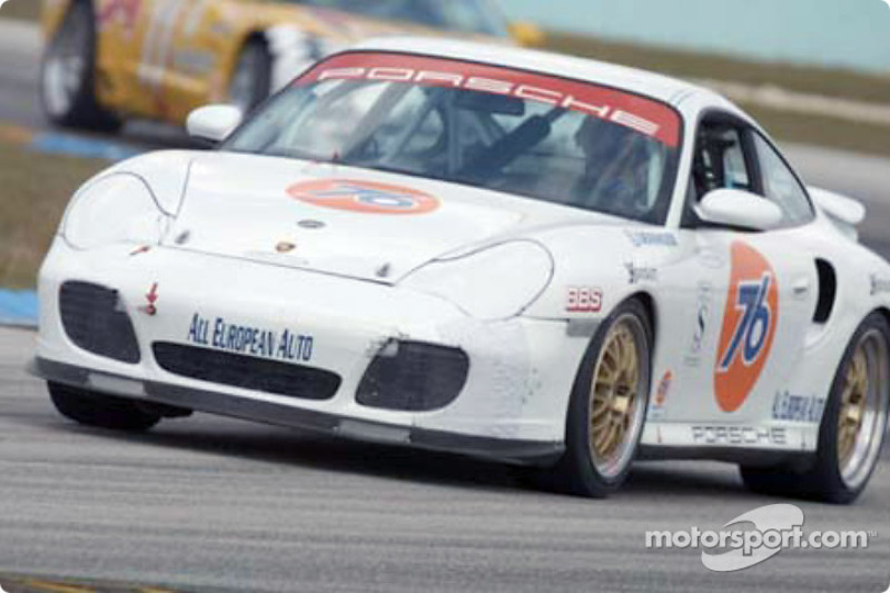 The #76 Team Hurricane Racing Porsche leads the field to the checkered flag