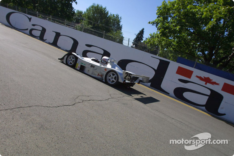 #25 Nissan Lola races past a Canada sign