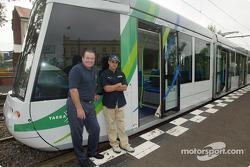 Compaq driver day: Alan Jones with Juan Pablo Montoya next to a Melbourne tram