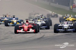 The start: Michael Schumacher battling with Juan Pablo Montoya