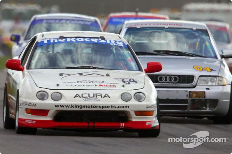The Sport Touring I-winninng #64 King Motorsports Acura Integra R leads a pack of cars during Sunday's Grand-Am Cup 250 at California Speedway