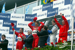 The podium: race winner Michael Schumacher with Rubens Barrichello and Ralf Schumacher