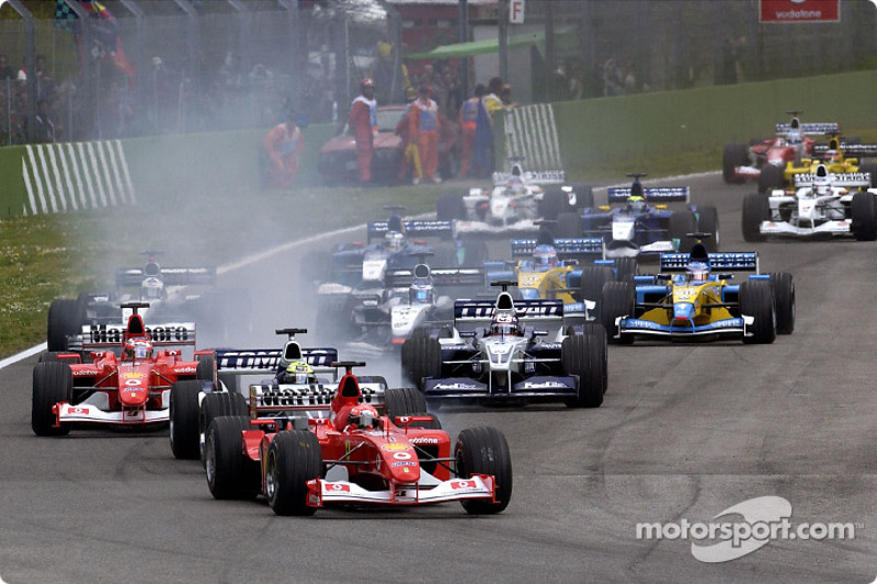 start: Michael Schumacher leading Ralf Schumacher ve Rubens Barrichello