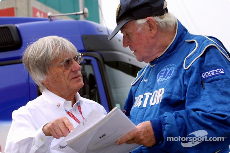 Bernie Ecclestone discussing with professor Sid Watkins