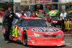 Jeff Gordon pushing his car back to the garage