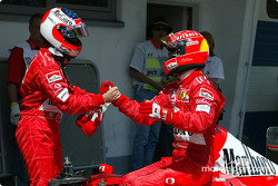 Michael Schumacher congratulating Rubens Barrichello