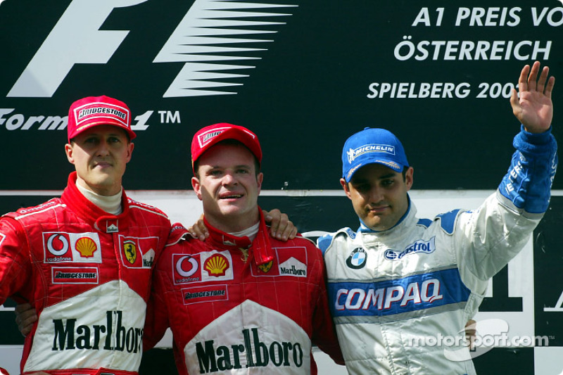 The podium: Michael Schumacher, Rubens Barrichello and Juan Pablo Montoya