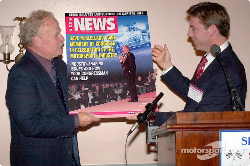 SEMA Senior VP Christopher Kersting presents a SEMA cover to Dave McClelland