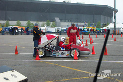 Rain comes, team covers engine only
