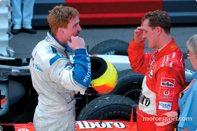 Ralf Schumacher delante de su hermano Michael
