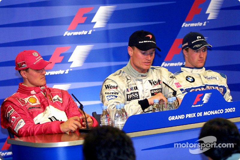 Winners' press conference: race winner David Coulthard with Michael Schumacher and Ralf Schumacher
