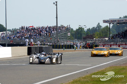 Team Cadillac Cadillac Northstar LMP-02 and the two Corvette Racing Chevrolet Corvette C5-R at the finish line