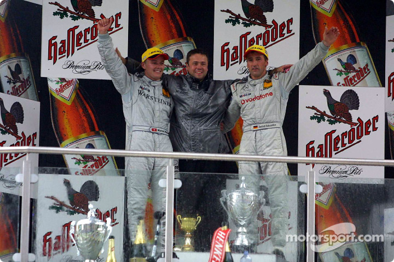 The podium: race winner Bernd Schneider, Marcel Fassler and chief designer Gerhard Ungar