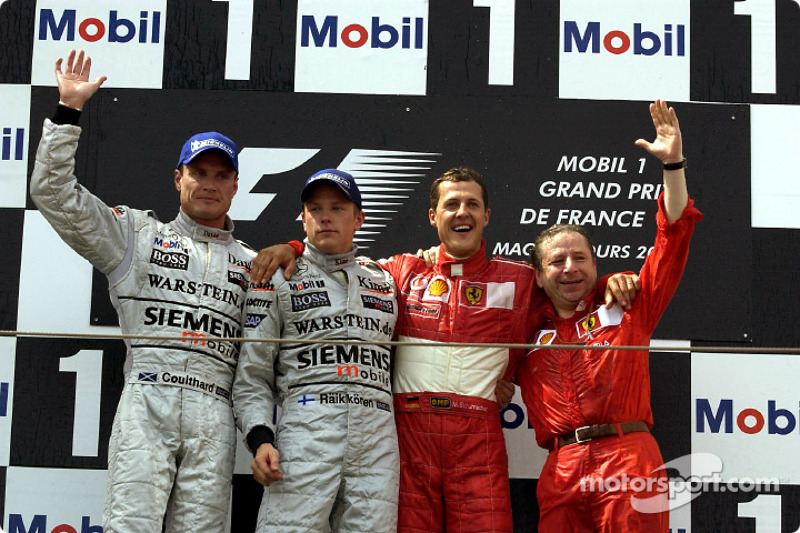 The podium: David Coulthard, Kimi Raikkonen, Michael Schumacher and Jean Todt