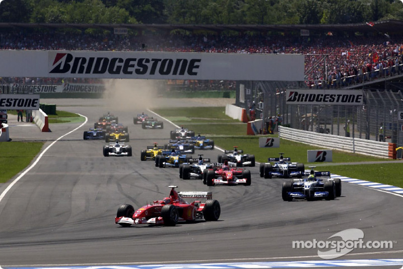 Second corner: Michael Schumacher leading Ralf Schumacher