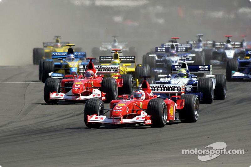 First corner: Rubens Barrichello leading Michael Schumacher and Ralf Schumacher