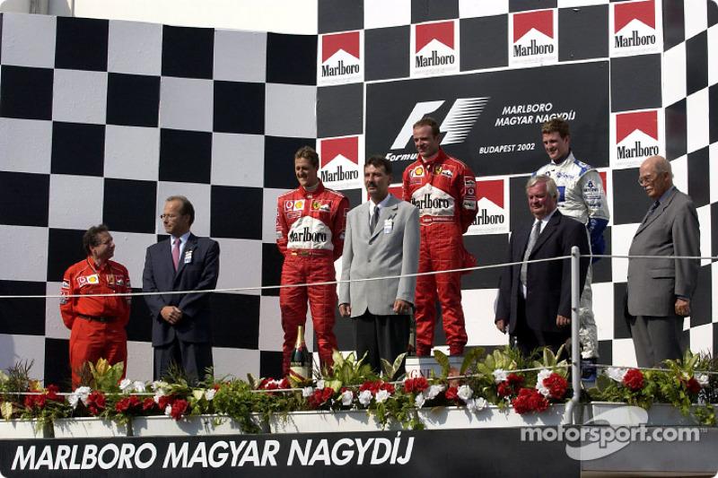 The podium: race winner Rubens Barrichello with Michael Schumacher and Ralf Schumacher