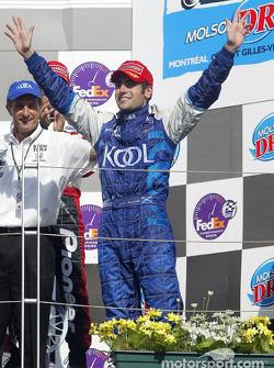 The podium: race winner Dario Franchitti