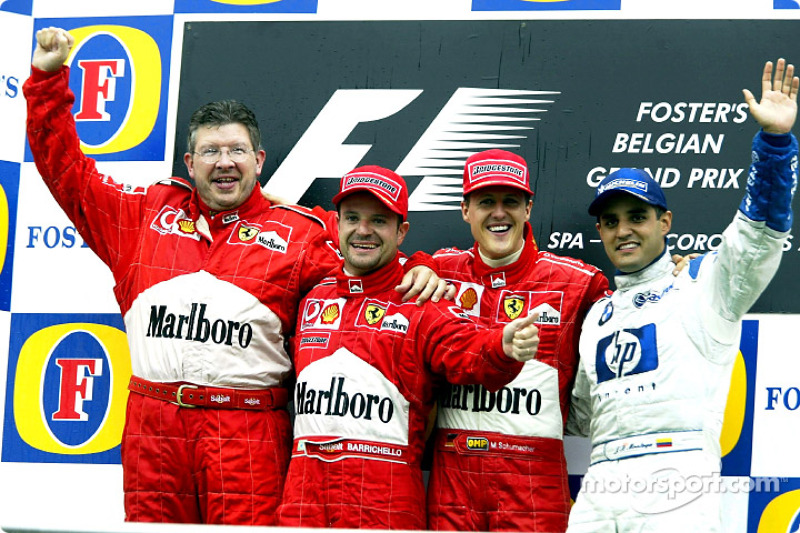 The podium: race winner Michael Schumacher with Ross Brawn, Rubens Barrichello and Juan Pablo Montoya