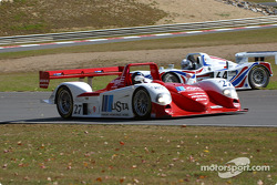 Pegasus Racing Porsche Lola spins while Didier Theys passes by
