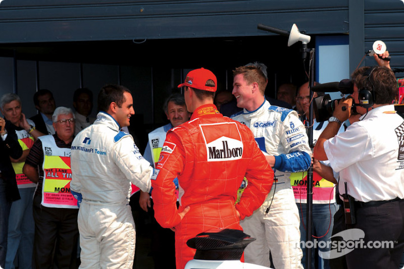 Pole winner Juan Pablo Montoya, Michael Schumacher and Ralf Schumacher