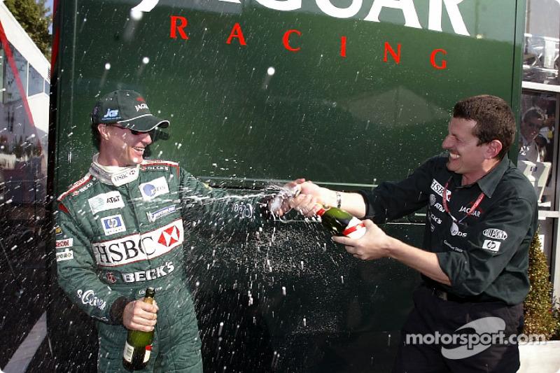 Eddie Irvine celebrates podium finish