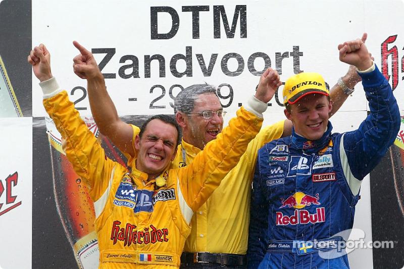 The podium: race winner Mattias Ekström with DTM 2002 Champion Laurent Aiello and Hans-Jürgen Abt