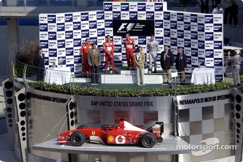 The podium: race winner Rubens Barrichello, Michael Schumacher and David Coulthard