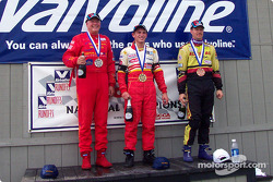 The podium: race winner Jamie Bach with Douglas Peterson and Kevin Roberts
