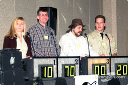 Tom Chemris (far right) in a round of Motorsports Trivia during Friday night activities at the Convention