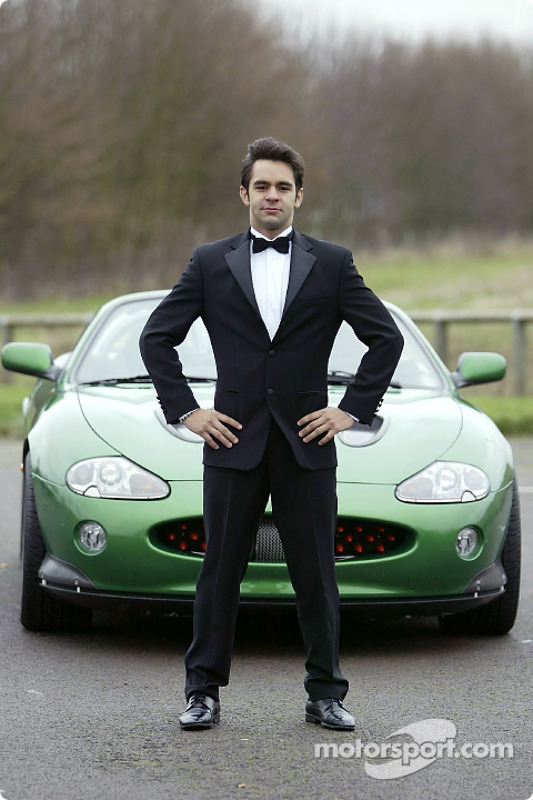 Antonio Pizzonia poses with the James Bond 007 XK-R during a photoshoot at the Jaguar Racing headqua