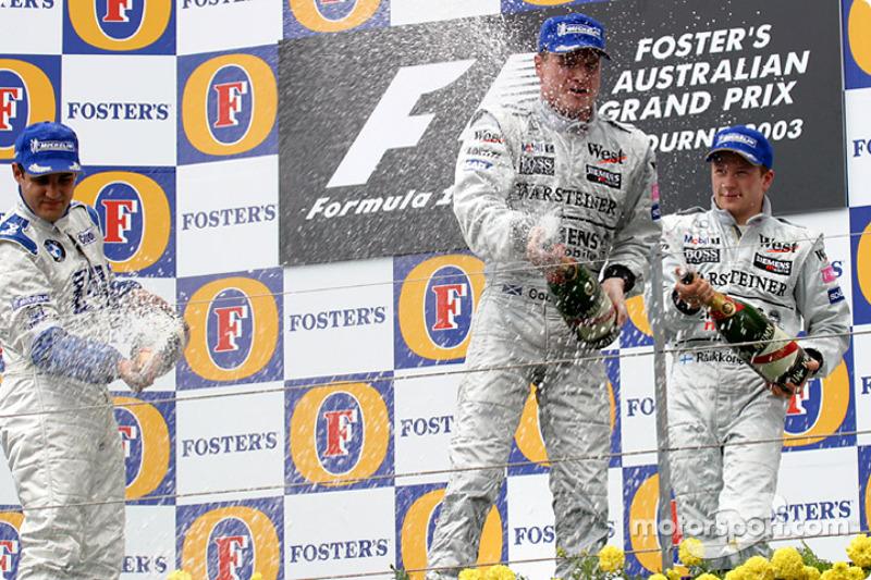 The podium: champagne for race winner David Coulthard, Juan Pablo Montoya and Kimi Raikkonen