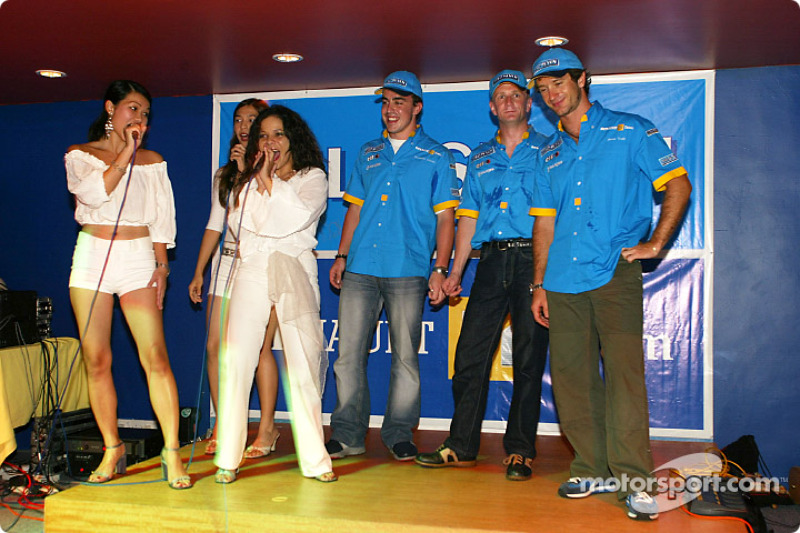 Renault F1 party in Sepang: Fernando Alonso, Allan McNish and Jarno Trulli on stage with performers