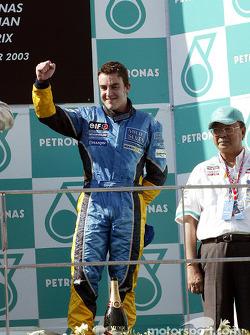 The podium: Fernando Alonso