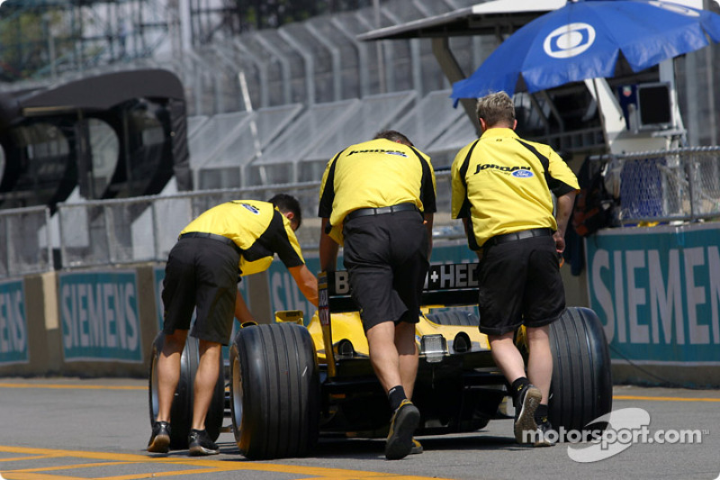 Jordan team members push the Jordan to technical inspection