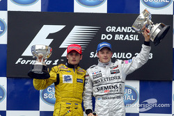 The podium: Giancarlo Fisichella and race winner Kimi Raikkonen