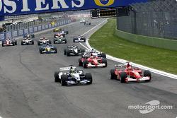 The start: Michael Schumacher and Ralf Schumacher battle for the lead