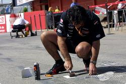 Minardi team member prepares pit area