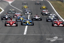 The start: Michael Schumacher takes the lead ahead of Fernando Alonso and Rubens Barrichello