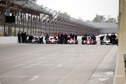 Five past winners takes a ceremonial lap around the track: Kenny Brack, Al Unser Jr., Helio Castroneves, Arie Luyendyk and Buddy Lazier