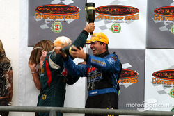 Team mates Marcos Ambrose and 3rd place Russell Ingall celebrate