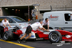 Toyota team members push the car to technical inspection